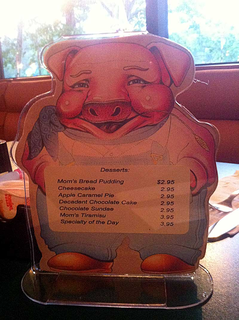 Funny and Scary Picture of an insane pig table place card (iPhone Photo by Your Host)