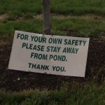 For your own safety please stay away from the pond. Thank you. (Cropped Closeup)
