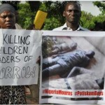 Protesters march against the killing of over 47 students of Potiskum Government Comprehensive School in Yobe State, Nigeria, Nov. 17, 2014.