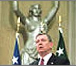Attorney General John Ashcroft in front Spirit of Justice statue