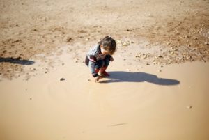A Syrian refugee child plays at Al Zaatari refugee camp in Jordan near the border with Syria, December 3, 2016. Photo by Muhammad Hamed/Reuters