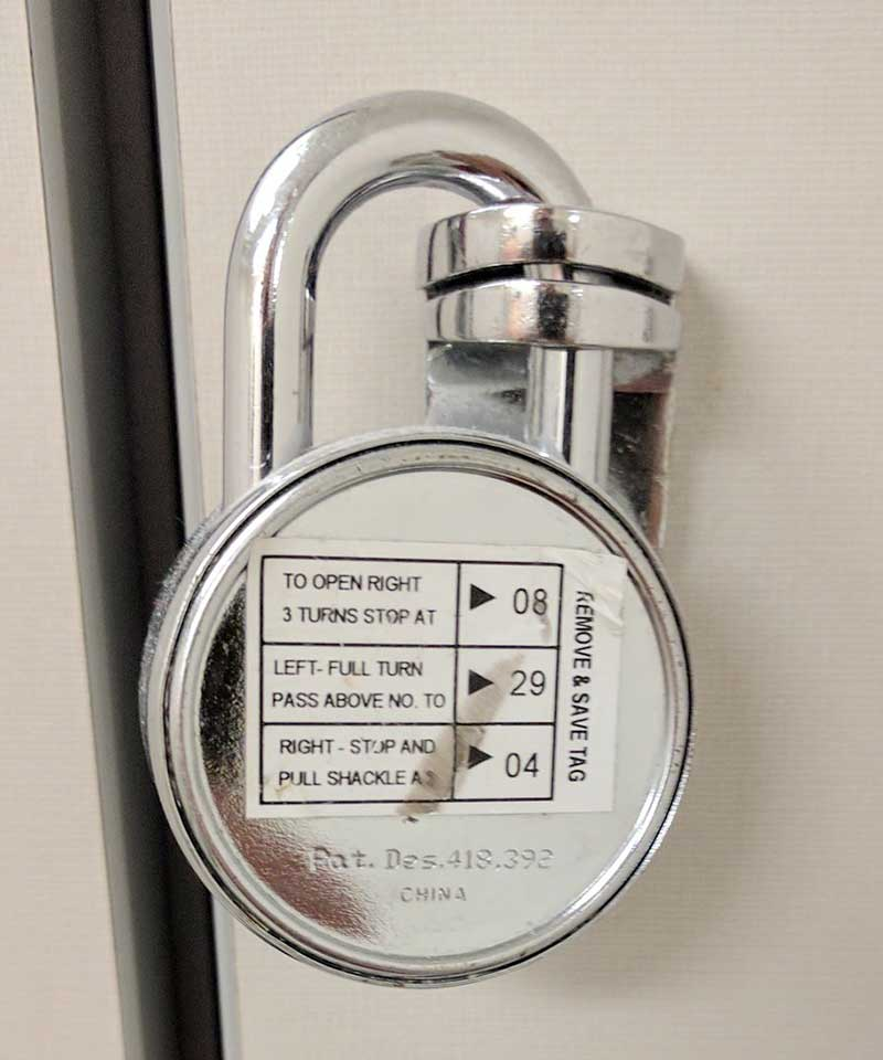Combination lock with security code sticker still on the back